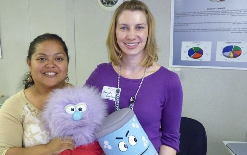Tanya Cruz from the Pinal Hispanic Council and Eloy Governor's Alliance Against Drugs Coalition and Hannah Carlson, Child Care Health Consultant with UACE pose with Tanya's substance prevention props.